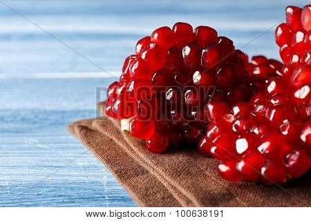 Fresh ripe garnet on wooden table close up