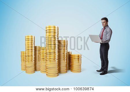 creative business man and gold coins concept