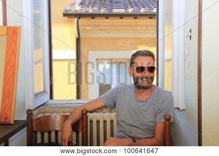 Man Sitting At The Window
