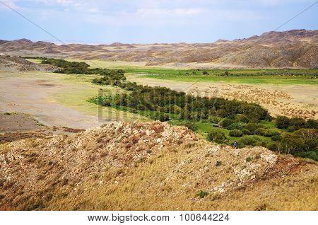 Little Boy In The Kazakhstan's Hills