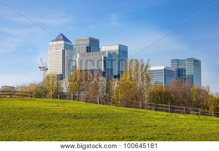 LONDON, UK - APRIL 14, 2015: London, Canary Wharf fire from the local farm fields.