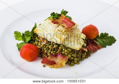 beautiful flow of white fish fillet with beetroot leaves and yellow sauce mung bean, lentil,