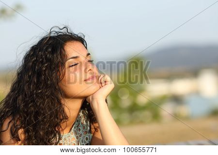 Woman Relaxing In A Warmth Park