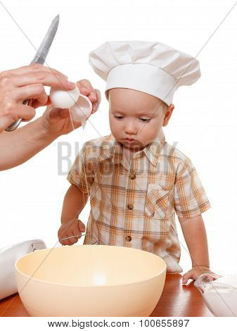 Mother And Son Preparing Cake In The Bowl Of A Blender. White Background