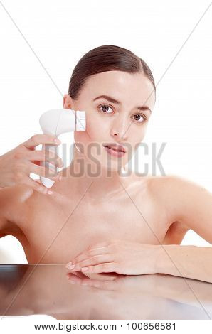 Woman With Brush For Deep Cleansing Facial. Skin Care Concept. High Technology Beauty