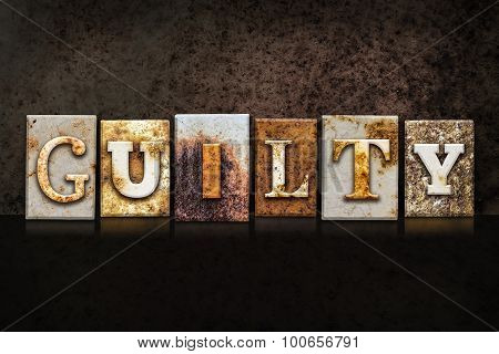 Guilty Letterpress Concept On Dark Background