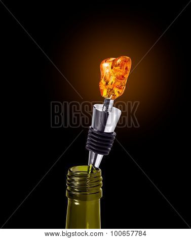 Bottle Of Wine With A Stopper From Amber Isolated On Black Background