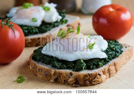 Spinach And Poached Egg On Brown Bread