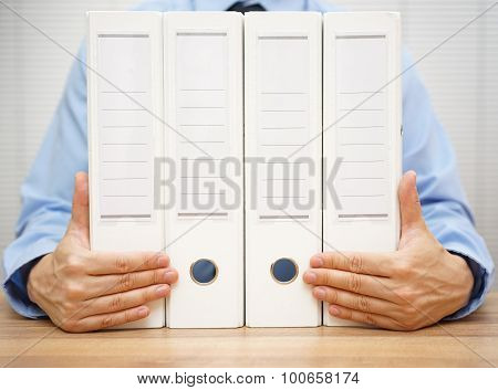 Businessman Holding Binders.  Accounting, Finance Or Law Concept