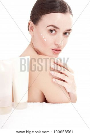 Young Woman With  A Well-groomed Skin Applying Beauty Product. Skincare Concept