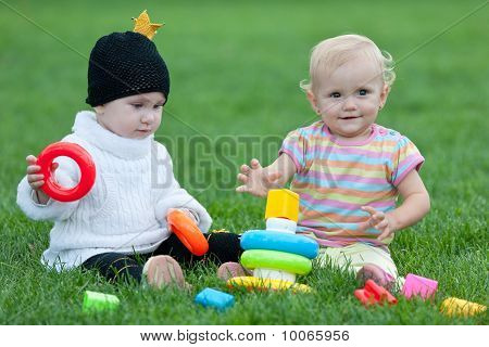 Two Little Girls Are Playing Outdoor