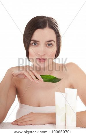 Woman With Well-groomed Skin Near Organic Cosmetics - Isolated On White Background. Skin Care Concep