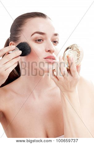 Beautiful Young Woman Preens With A Brush For Blush, Look In The Mirror. Isolated On White Backgroun