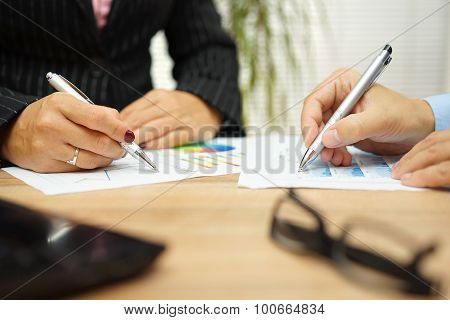 Businesswoman And Businessman Are Discussing About Financial Data On Meeting