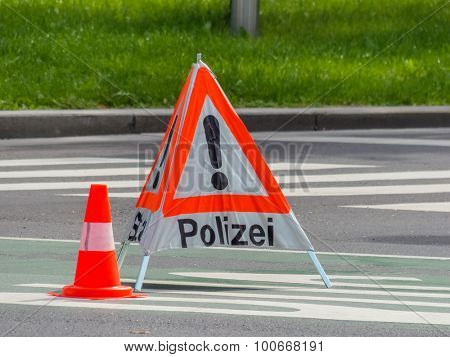 a road is blocked in a police operation.