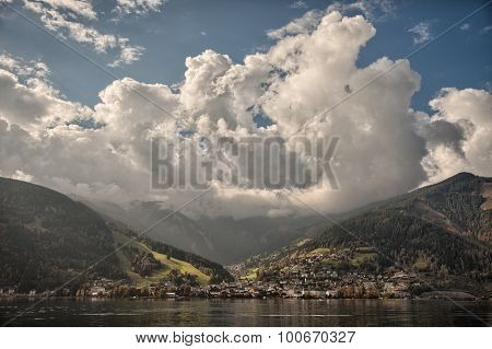 Mountain peaks puffy clouds and Zeller lake views from Zell am See Austria