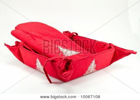 Red oven glove and bread basket