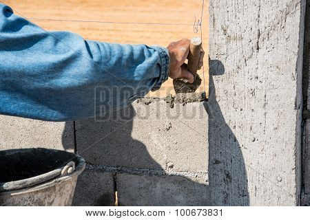 Orker Make Concrete Wall By Cement Block And Plaster At Construction Site ,worker Hand Wearing Glove