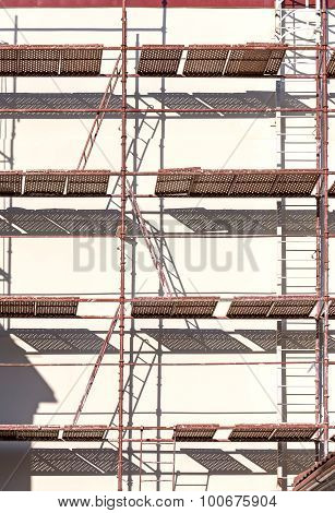 Scaffold With Ladders At House Facade