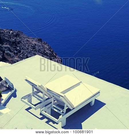 Sunbeds On The Terrace And Sea On Santorini Island, Greece.