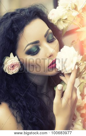 Portrait Of Attractive Woman With Flower In Hair