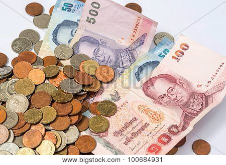 Pile Of Coins And Banknotes Money, Baht Currency Of Thailand On White Background.