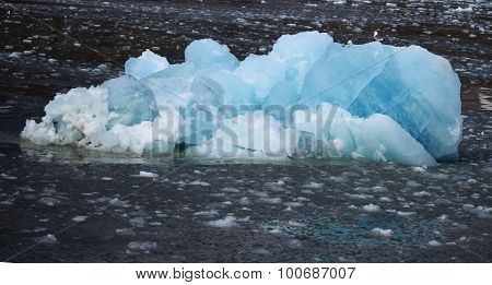 White and blue ice small icebergs floating in Svalbard Norway