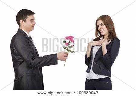 Young man gives a branch of flowers to beautiful lady