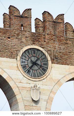 Clock On Portoni Della Bra In Verona, Italy