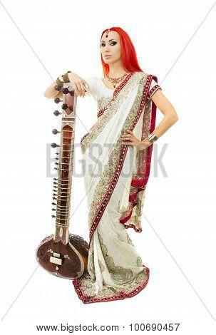 Beautiful Redhead Woman In Indian Sari With Oriental Jewelry Posing With Sitar