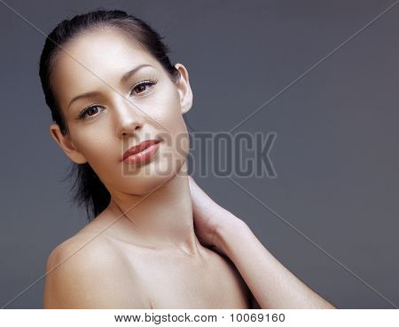 Woman Touching Neck