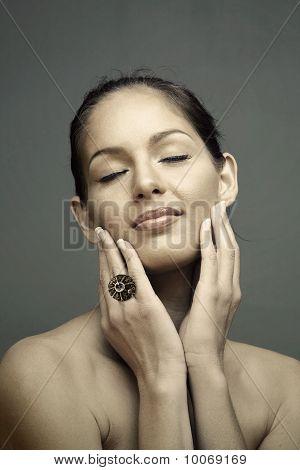 Woman Touching Face