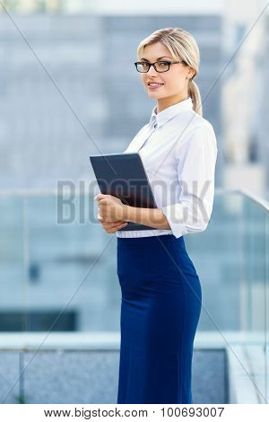 Upbeat businesswoman holding laptop