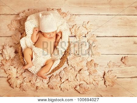 Baby Sleeping On Autumn Wood, New Born Kid Asleep In Leaves, Newborn Lying In Decorated Background,
