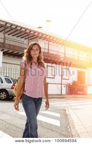 Beautiful Woman Walking Down The Street At Sunset
