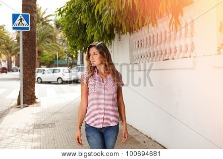 Young Woman Smiling While Walking Outdoors