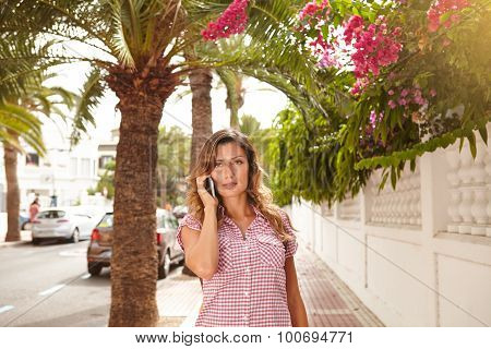 Beautiful Woman Talking On Cell Phone Outdoors