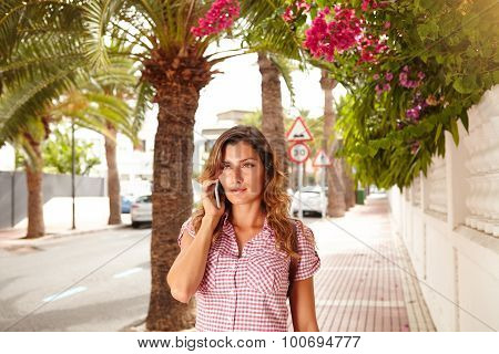 Young Woman Talking On Mobile Phone Outdoors