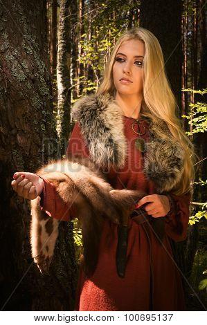Scandinavian Girl  With Fur Skins