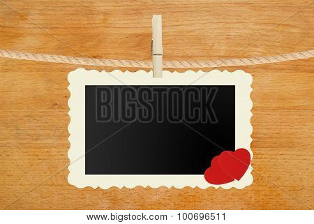 Photo Paper Hanging With Two Red Hearts On Rope On Wooden Background