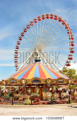 CHICAGO, ILLINOIS - AUGUST 22, 2015: Navy Pier rides. The Ferris Wheel and Carousel are popular attractions on Chicago's Navy Pier on Lake Michigan.