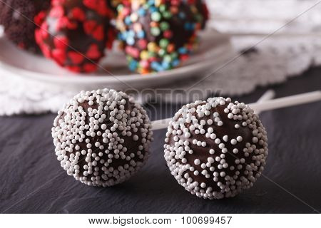 Two Chocolate Cake Pops With White Candy Sprinkles Close-up. Horizontal