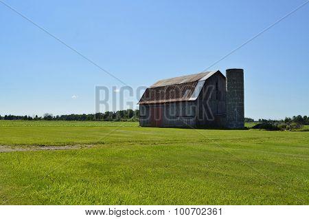 Weathered vintage barn on farmland