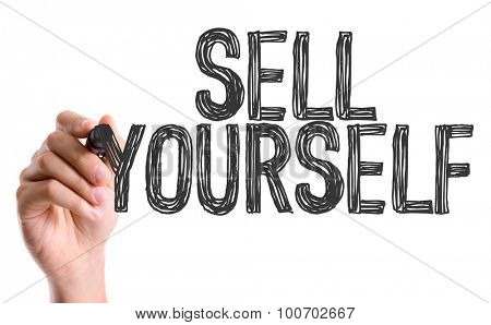 Hand with marker writing the word Sell Yourself