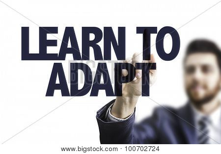 Business man pointing the text: Learn to Adapt