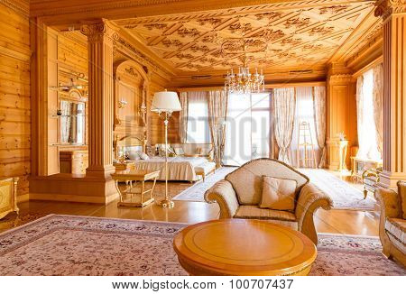 Novi Petrivtsi, Ukraine - May 27, 2015 Mezhigirya residence of ex-president of Ukraine Yanukovich. Luxurious wooden living room interior