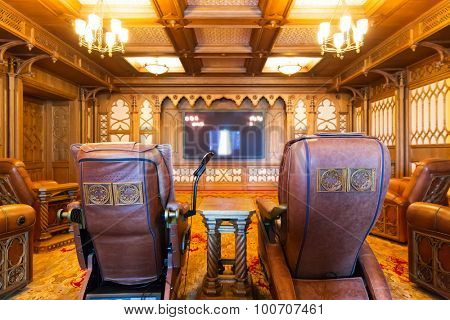 Novi Petrivtsi, Ukraine - May 27, 2015 Mezhigirya residence of ex-president of Ukraine Yanukovich. Modern home theater room interior with soft comfortable chairs