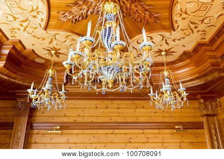 Novi Petrivtsi, Ukraine - May 27, 2015 Mezhigirya residence of ex-president of Ukraine Yanukovich. Close up of modern gilded chandeliers