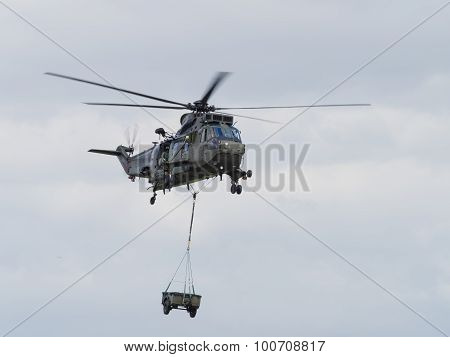 Military Helicopter Lifting Load