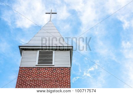 Rural Church Steeple with Blue Sky and White Clouds